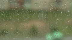 Close up image of rain drops falling on a window - stock footage
