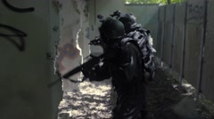 Slow Motion – A Special Force Team controll outside some bedraggled kennels. Stock Footage