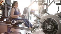 Woman using a rowing machine Stock Footage
