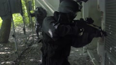 Slow Motion – A Special Force squad controll outside some bedraggled kennels. Stock Footage