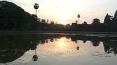 Sunrise Pokes Through Clouds At Angkor Wat In Siem Reap Cambodia Stock Footage