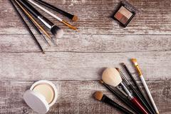 Cosmetics and make-up products on wooden table Stock Photos