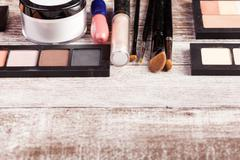 Cosmetics and make up elements on table - stock photo