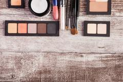 Cosmetics and make up elements on table Stock Photos