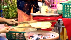 """Local Cook local dessert Hand making Thai rice crispy called """"Khao Kriapat"""" - stock footage"""