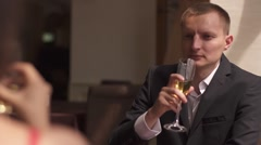 Elegant wealthy couple in love drinking champagne in a date in luxury restaurant Stock Footage