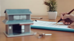 Realtor signing contract - stock footage