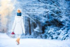 Adorable little girl with flashlight in winter on Christmas outdoors Stock Photos
