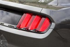 Red Backlight of a grey sport car - stock photo