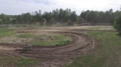 4k aerial motocross bike hitting two sandy corners - stock footage