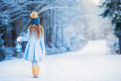 Little adorable girl with in winter day outdoors Stock Photos