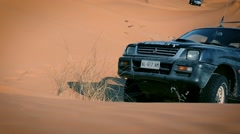 Driving off road car in the sahara desert Stock Footage