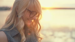 Happy girl with glasses using tablet in bright summer. Closeup. RAW video record Stock Footage