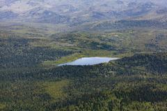 Scenic view from mountain, lake in valley Stock Photos