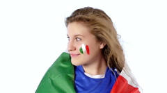 Girl with Italian flag on her shoulders and cheeks smiling, slow motion - stock footage