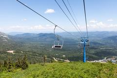 Chairlift, view from high mountain, summer landscape - stock photo