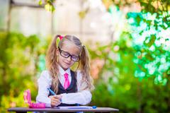 Adorable little school girl outdoor. Back to school - stock photo