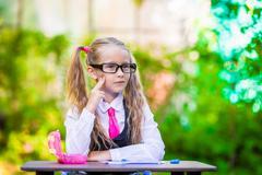 Adorable little school girl outdoor. Back to school Stock Photos