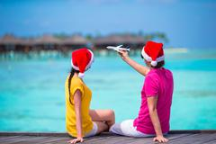 Couple in Santa Hats on a tropical beach at Maldives Kuvituskuvat