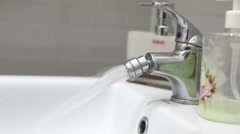 Water flowing from the faucet. Faucet is opened on the bidet. Stock Footage