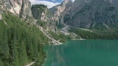 Drone aerial flying over a scenic Lago di Braies in Dolomites, Italy Alps Stock Footage