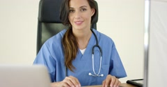 Beautiful female doctor at laptop computer Stock Footage