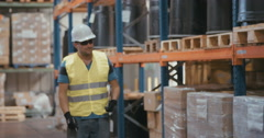 Slow motion shot of a logistics worker in a warehouse - stock footage