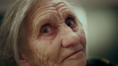 Old woman face with deep wrinkles. Elderly woman looking at the camera. Stock Footage