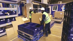 Workers unloading boxes with details Stock Footage
