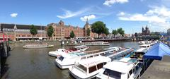 Canal cruise boats in Amsterdam Stock Photos