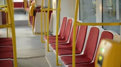 Beautiful young woman enters tram and sits on the seat.  Stock Footage