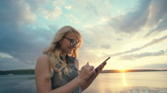 Woman using digital tablet. Hipster girl browsing Internet, searching for maps Stock Footage