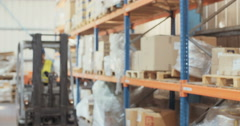 Slow motion shot of a Logistics man getting off a forklift and inspecting items Stock Footage