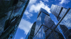 Modern reflective skyscrapers against cloudy sky 4K time lapse. View from below Stock Footage