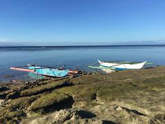 Catamaran Boats at the reef during low tide Stock Photos