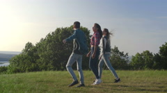Group Of Friends rejoice on a high hill at sunset Stock Footage