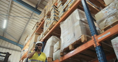 Low angle slow motion shot of a logistics man in a warehouse Stock Footage