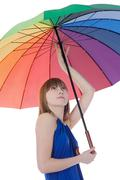 Lovely young lady standing with color umbrella - stock photo