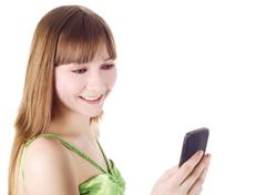 Bright picture of happy blonde with cell phone Stock Photos