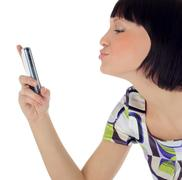 Bright picture of happy woman with cell phone Stock Photos