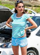 Sadness woman is standing near broken car Stock Photos