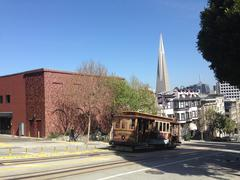 Cable car and the Transamerica Pyramid - stock photo