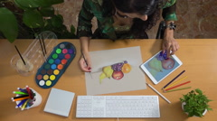Woman looking a picture with digital tablet and painting Stock Footage