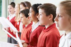 Group Of Children Singing In School Choir Stock Photos