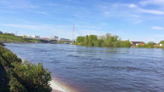 The rapid flow of the river, the promenade in the city center Stock Footage