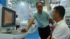 Medical equipment exhibition, testing the body Stock Footage