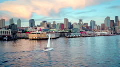 Sailboat crosses water by Seattle skyline 3 Stock Footage