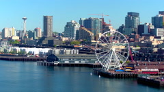 Aerial view of ferris wheel in front of Seattle skyline 2 Arkistovideo