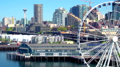 Aerial view of ferris wheel in front of Seattle skyline 4 Stock Footage
