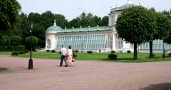 The big stone orangery. People walk in the park of Kuskovo. Stock Footage